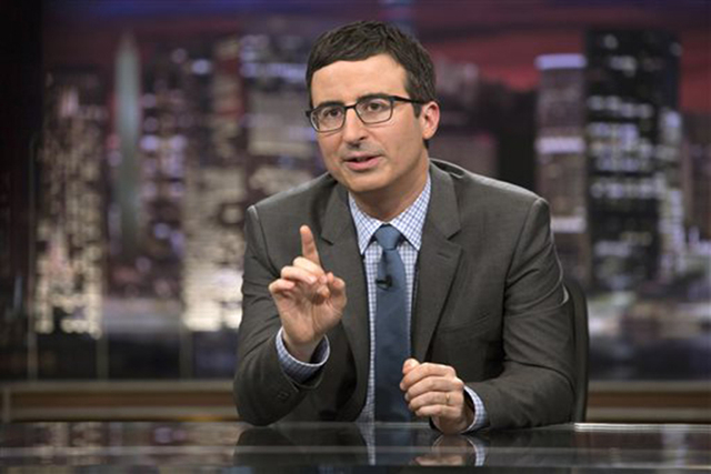 "In this April 2014 image released by HBO, host John Oliver speaks during ""Last Week Tonight with John Oliver,"" in New York. Oliver, who subbed for Jon Stewart as host of ""The Daily  ..."