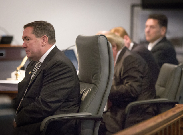 Former Clark County District Attorney David Roger, left, testifies during a Nevada Commission on Judicial Discipline hearing for suspended Family Court Judge Steven Jones on Monday. On the far rig ...