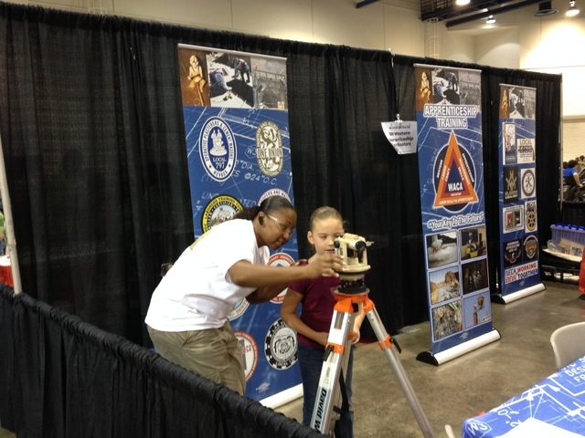 Jovan Johnson shows children different construction tools at the World of Girls event Aug. 30 at Cashman Center. (Special to the Las Vegas Review-Journal)