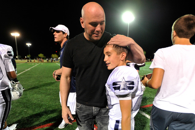UFC president Dana White congratulates his son, Aidan, after his football game at All-American Park in Las Vegas on Tuesday, Sept. 23, 2014. (David Becker/Las Vegas Review-Journal)