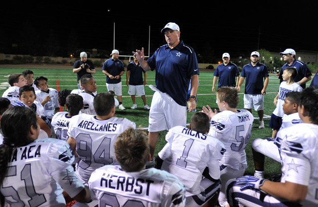 Coach David White speaks with his football team after their game at All-American Park in Las Vegas on Tuesday, Sept. 23, 2014. (David Becker/Las Vegas Review-Journal)