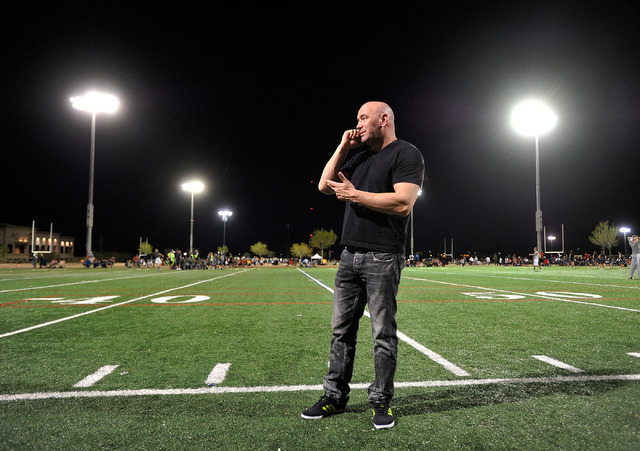 UFC president Dana White speaks on his phone during half time at his son's football at All-American Park in Las Vegas on Tuesday, Sept. 23, 2014. (David Becker/Las Vegas Review-Journal)