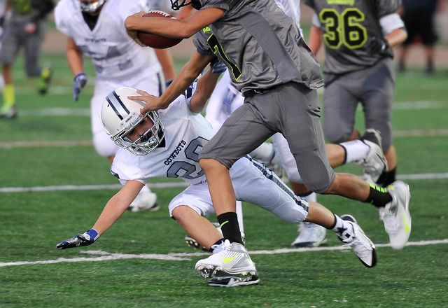 Aidan White (29) attempts to make a tackle during his football game at All-American Park in Las Vegas on Tuesday, Sept. 23, 2014. (David Becker/Las Vegas Review-Journal)