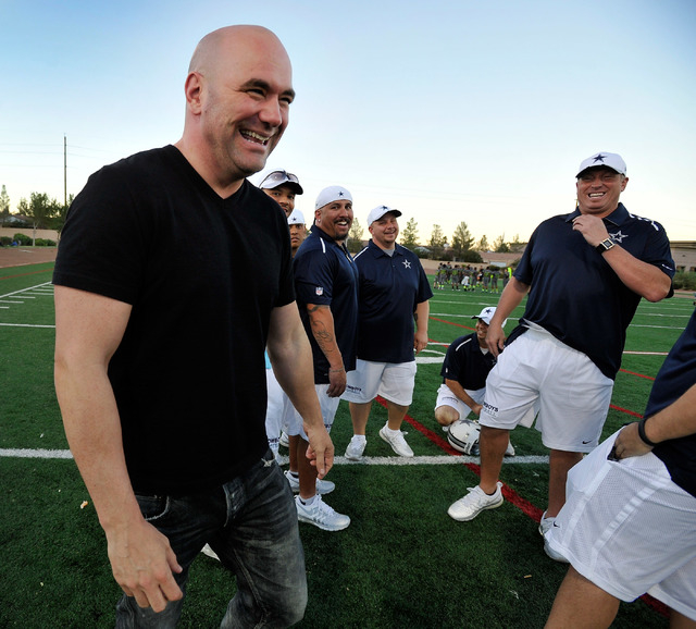 UFC president Dana White, left, smiles with the coaches of his son's football team after a game at All-American Park in Las Vegas on Tuesday, Sept. 23, 2014. (David Becker/Las Vegas Review-Journal)