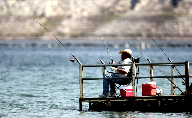 Fishermen cast lines off the dock near Hemenway Fishing Point at the Lake Mead National Recreation Area on Wednesday, March 25, 2009. (John Gurzinski/Las Vegas Review-Journal)