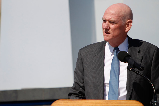 Clark County Commissioner Larry Brown, shown during the 9/11 Memorial Service on Sept. 11, 2014, said on Tuesday to let the free market figure out how much square footage Nevada needs for medical  ...