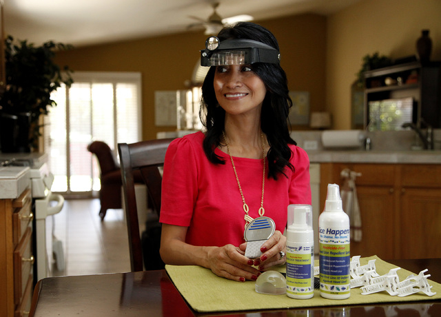 Michelle Lohrli, owner of Lice Happens, sits in her Henderson home with toosl she uses to remove lice from her client's hair and scalp on Monday, Sept. 22, 2014. (Justin Yurkanin/Las Vegas Review- ...