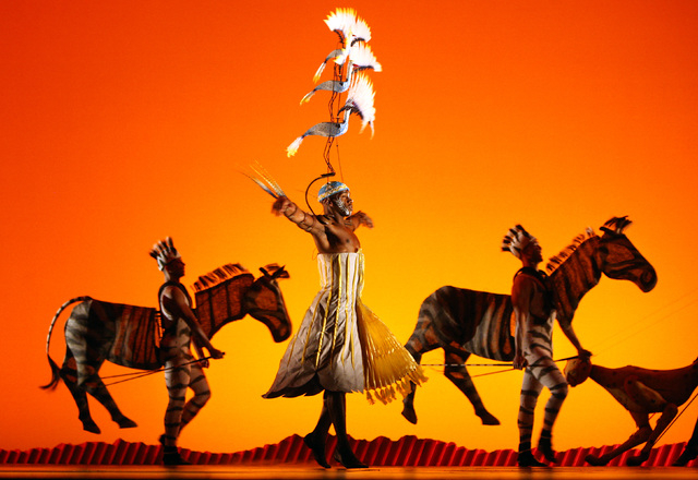 """Cast members perform the opening scene of the Disney musical """"The Lion King"""" at Mandalay Bay hotel-casino on May 11, 2009, in Las Vegas. (John Gurzinski/Las Vegas Review-Journal)"""