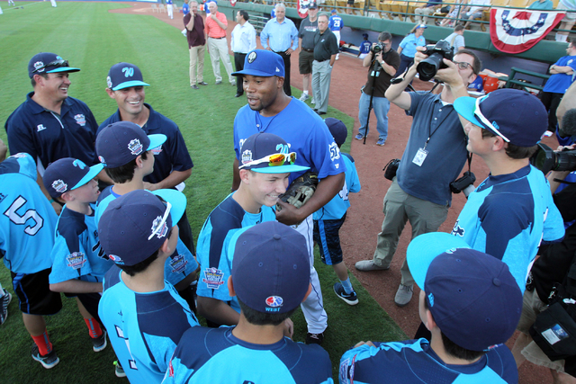 Members of the Mountain Ridge Little League baseball team visit with Las Vegas 51s first baseman Brandon Allen before the 51s take on the Reno Aces in Game 1 of their PCL Conference Championship S ...