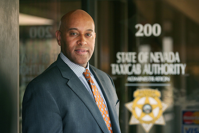 Taxicab Authority Administrator Charles Harvey stands near the entrance to the State of Nevada Taxicab Authority located at 1785 E. Sahara Ave. #200 Wednesday, March 5, 2014, in Las Vegas. Harvey  ...