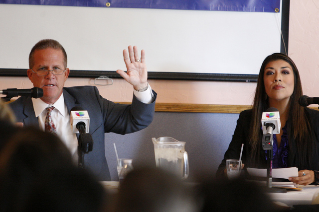 Nevada lieutenant governor candidates, State Sen. Mark Hutchison, R-Las Vegas, left, and Assemblywoman Lucy Flores, D-Las Vegas, participate during their first race debate at Dona Maria Tamales re ...