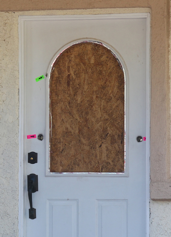 Bullet holes are seen Wednesday, Sept. 17, 2014, in the door at 7779 Maverick St. in Las Vegas where a 15-year-old boy fired a shotgun from outside into the door on Tuesday, Sept. 16, 2014. Someon ...