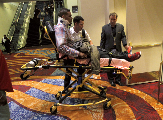 A man is wheeled out on a stretcher after the Floyd Mayweather Jr. and Marcos Maidana fight at the MGM Grand Garden Arena in Las Vegas on Saturday, Sept. 13, 2014. (Sam Morris/Las Vegas Review-Jou ...