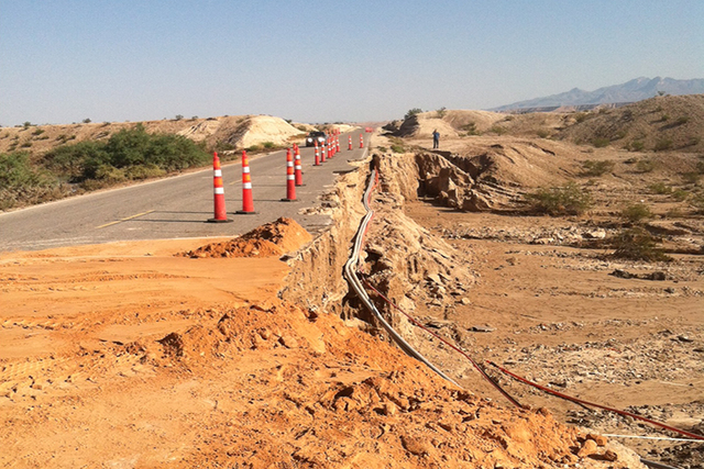 The photo features Henrie Road, a main route into Moapa. The road remains open, but has what Clark County called severe damage. (courtesy Clark County Public Communications)