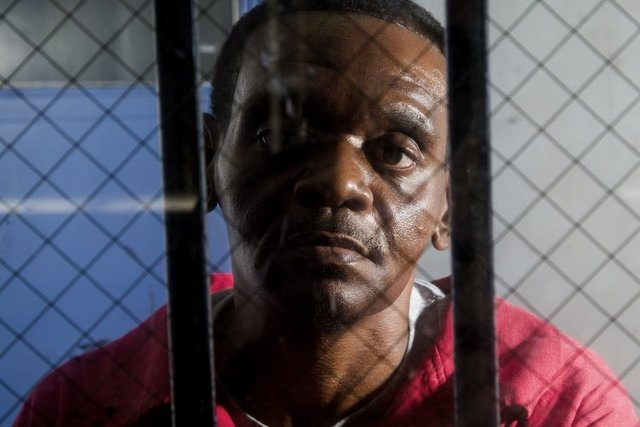 In an an Aug. 12, 2014 photo, Henry McCollum sits on death row at Central Prison in Raleigh, N.C. He and his half brother Leon Brown have spent more than three decades in prison for the rape and m ...
