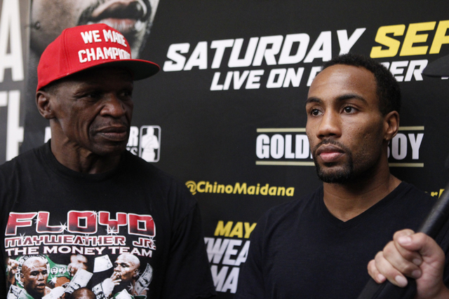Trainer Floyd Mayweather Sr., left, and boxer Mickey Bey, speak to the media during an interview about their upcoming fight at Mayweather Boxing Club in Las Vegas, Tuesday, Sept. 2, 2014. (Erik Ve ...