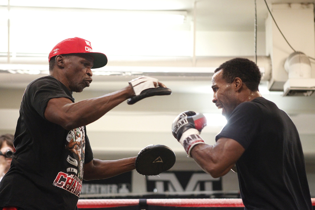 Trainer Floyd Mayweather Sr., left, and boxer Mickey Bey, train inside the ring during a media day at Mayweather Boxing Club in Las Vegas, Tuesday, Sept. 2, 2014. (Erik Verduzco/Las Vegas Review-J ...