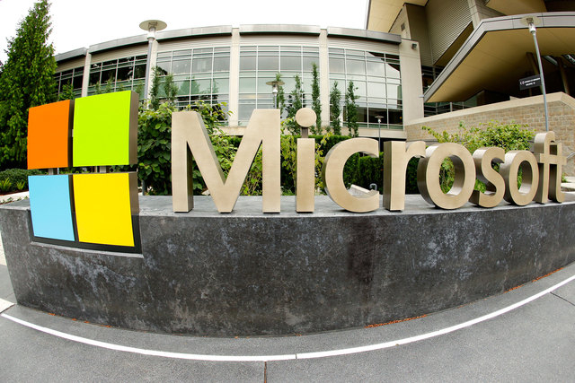 Microsoft Corp. signage is shown outside the Microsoft Visitor Center in Redmond, Washington. The company will unveil a new name for its best-known product on Tuesday when it offers the first offi ...