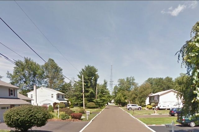 The 400 block of Adams Avenue in Middletown, Pa., is shown in this screen grab from Google Maps. Police say a man claimed he shot his neighbor's house on this block because he didn't know how else ...