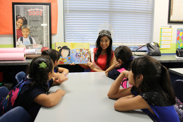 Reigning Miss Asian Las Vegas Catherine Ho reads to students at the Lied Memorial Boys & Girls Clubhouse, 2850 S. Lindell Road, Sept. 8 for International Literacy Day. Miss Asian Las Vegas delegat ...