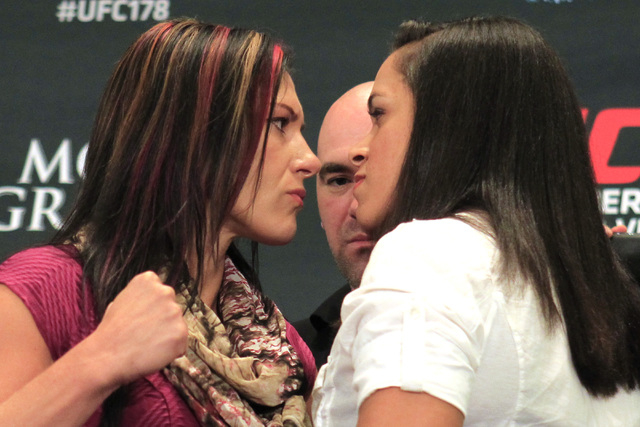 Cat Zingano, left, and Amanda Nunes face off during media day in advance of UFC 178 Thursday, Sept. 25, 2014 at the MGM Grand. (Sam Morris/Las Vegas Review-Journal)