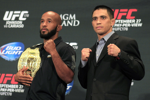 Flyweight champion Demetrious Johnson, left, and Chris Cariaso pose for photos during media day in advance of UFC 178 Thursday, Sept. 25, 2014 at the MGM Grand. (Sam Morris/Las Vegas Review-Journal)