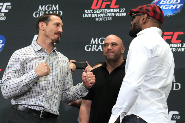 Tim Kennedy, left, and Yoel Romero face off during media day in advance of UFC 178 Thursday, Sept. 25, 2014 at the MGM Grand. (Sam Morris/Las Vegas Review-Journal)