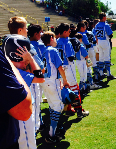 Mountain Ridge Little League players line up before a game, Aug. 9, 2014. (Special to View)