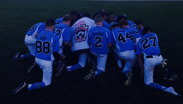 Mountain Ridge Little League players huddle before a game, July 24, 2014. (Special to View)
