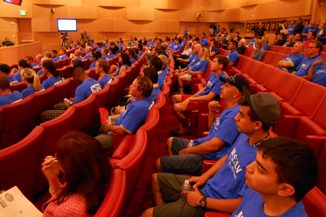 Pro soccer stadium fans sit at Las Vegas City Hall in Las Vegas, Nev., on Wednesday, Sept. 3, 2014, before the Las Vegas City Council vote on a potential deal for a stadium in Las Vegas. (Alan Sne ...