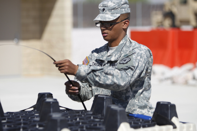 Nevada National Guard Spc. Tino Taitano zips a container to be shipped at the North Las Vegas Readiness Center in North Las Vegas Friday, Sept. 12, 2014. Next week, 29 Nevada National Guard member ...