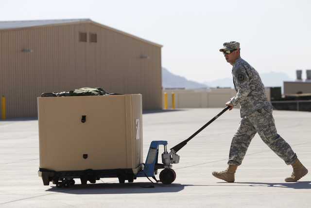 Nevada National Guard Sfc. Kevin Johnson moves unit equipment at the North Las Vegas Readiness Center in North Las Vegas Friday, Sept. 12, 2014. Next week, 29 Nevada National Guard members in Nort ...