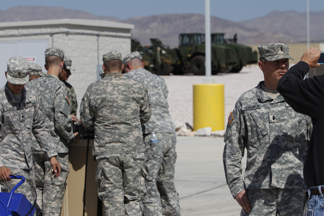 Nevada National Guard Lt. Jeffrey Hopkinson, right, is interviewed at the North Las Vegas Readiness Center in North Las Vegas Friday, Sept. 12, 2014. Next week, 29 Nevada National Guard members in ...