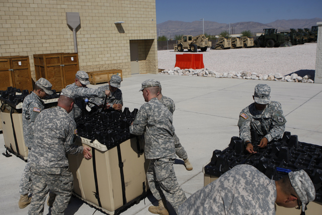 Military members of the Nevada National Guard pack unit equipment to ship at the North Las Vegas Readiness Center in North Las Vegas Friday, Sept. 12, 2014. Next week, 29 Nevada National Guard mem ...