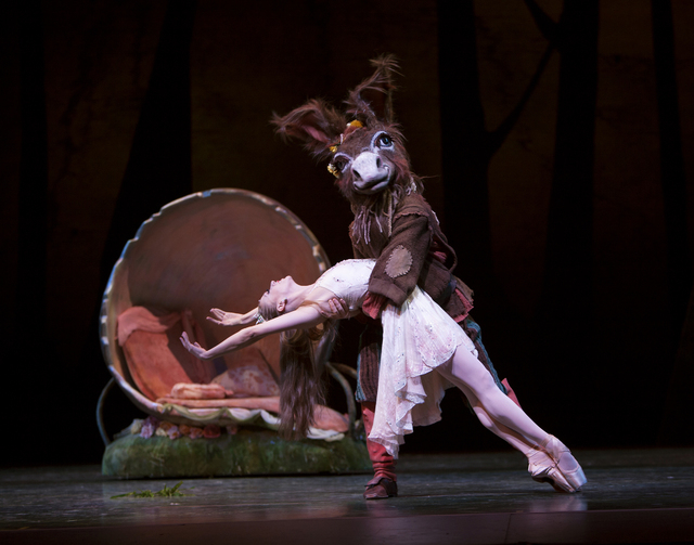 """Besotted fairy queen Titania (Lesley Rausch) dances with weaver Bottom -- who's been turned into an ass by her jealous husband, Oberon -- in """"A Midsummer Night's Dream."""" Rausch will dance the role ..."""