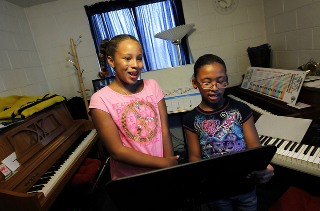 Friends Faith Miller-Hooks, left, and Shylin Thompson get a singing lesson at The Rockin' Music Zoo in Las Vegas on July 31, 2014. (Jason Bean/View)