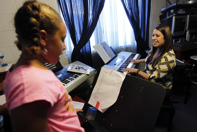 Faith Miller-Hooks, left, gets a singing lesson from instructor Megan Schnizlein at The Rockin' Music Zoo in Las Vegas on July 31, 2014. (Jason Bean/View)