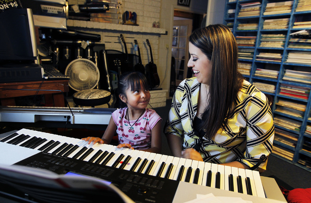 Instructor Megan Schnizlein, right, gives Nataly Miller-Hooks a piano lesson at The Rockin' Music Zoo in Las Vegas on July 31, 2014. (Jason Bean/View)