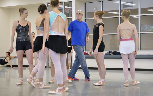 """Artistic Director James Canfield, center, talks with dancers, from left, Alissa Dale, Krista Baker, Kaleigh Schock, Mary LaCroix and Caroline MacDonald during a rehearsal for """"Seasons"""" a ..."""