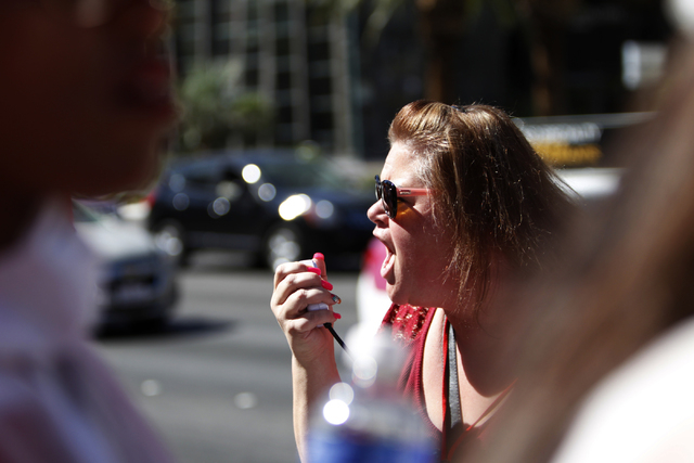 Cheli Guzman yells a chant during a rally and march by the California Nurses Association/National Nurses Organizing Committee outside of Planet Hollywood casino-hotel in Las Vegas Wednesday, Sept. ...