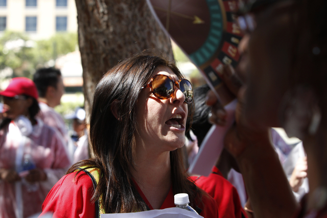 Labor representative Christa Indriolo yells a chant during a rally and march by the California Nurses Association/National Nurses Organizing Committee on the Strip near Planet Hollywood casino-hot ...