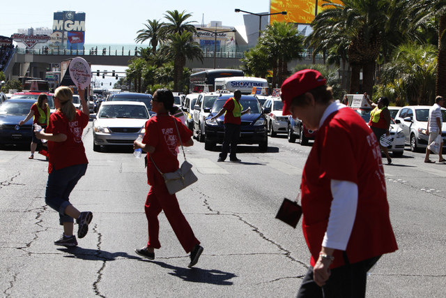 Traffic is stopped for members of the California Nurses Association/National Nurses Organizing Committee as they return to Planet Hollywood casino-hotel for their convention from a rally and march ...