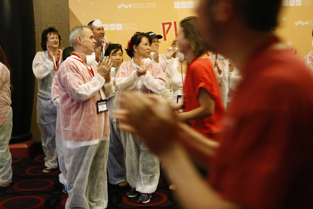 Registered nurses with the California Nurses Association/National Nurses Organizing Committee get ready for their rally and march at Planet Hollywood casino-hotel in Las Vegas Wednesday, Sept. 24, ...