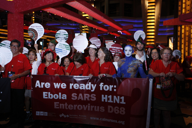 Registered nurses with the California Nurses Association/National Nurses Organizing Committee begin their rally at Planet Hollywood casino-hotel in Las Vegas Wednesday, Sept. 24, 2014. Registered  ...