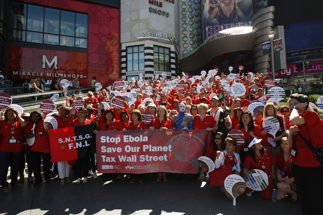 Registered nurses with the California Nurses Association/National Nurses Organizing Committee rally outside of Planet Hollywood casino-hotel in Las Vegas Wednesday, Sept. 24, 2014. Registered nurs ...