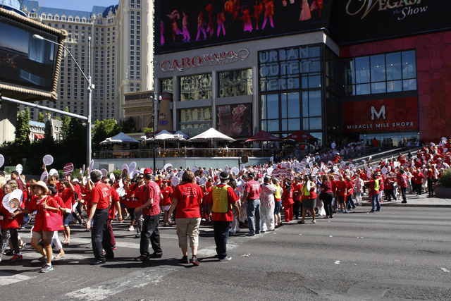 Registered nurses with the California Nurses Association/National Nurses Organizing Committee begin their march and rally outside of Planet Hollywood casino-hotel in Las Vegas Wednesday, Sept. 24, ...