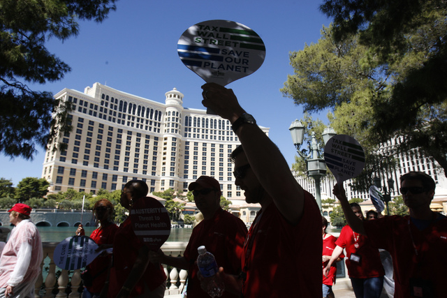Registered nurses with the California Nurses Association/National Nurses Organizing Committee march during a rally on the Strip near Planet Hollywood casino-hotel in Las Vegas Wednesday, Sept. 24, ...