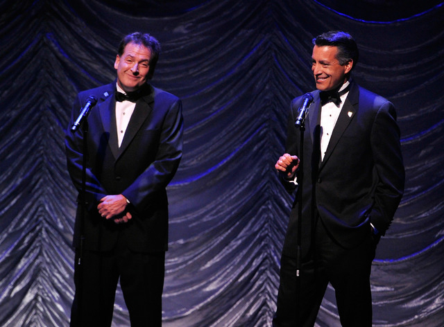 Lt Gov. Brian Krolicki, left, and Gov. Brian Sandoval speak  during the Nevada Sesquicentennial All-Star Concert at The Smith Center on Monday, Sept. 22, 2014, in Las Vegas. The variety show, feat ...