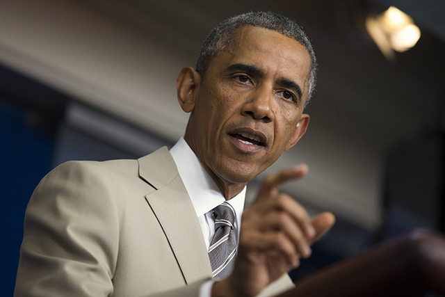 This file photo shows President Barack Obama speaking on Aug. 28, 2014. (AP Photo/Evan Vucci, File)