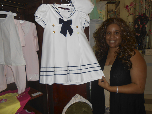 Stephanie Mitchell-Anthony talks about her shop, Pas De Deux Children's Couture, which opened June 6, 2014. She carries vintage chic clothing for children up to age 10, such as the sailor dress  ...